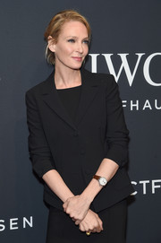 Uma Thurman accessorized with a classic leather-band quartz watch at the IWC Schaffhausen Tribeca Film Fest event.