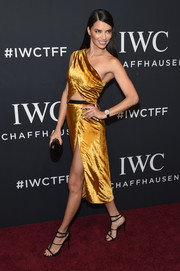 Adriana Lima looked foxy in a gold Jason Wu one-shoulder dress with a midriff cutout and a high side slit at the IWC Schaffhausen Tribeca Film Fest event.