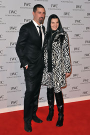 Margherita Ronchi wore black knee-high boots with her zebra-print pantsuit for a chic 60's feel.