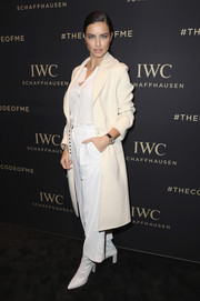 Adriana Lima stayed warm in classic style with a cream-colored wool coat while attending the IWC Schaffhausen Da Vinci Collection launch.