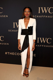 Naomie Harris completed her look with simple black ankle-strap sandals by Gianvito Rossi.