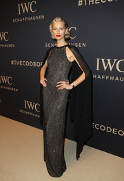 Karolina Kurkova looked quite the diva in a caped black mesh gown by Michael Kors at the IWC Schaffhausen 'Decoding the Beauty of Time' gala.