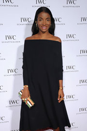 Genevieve Jones carried a stunning multicolored striped cylindrical clutch at 'For the Love of Cinema' event.