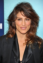 Jennifer Esposito wore her wavy layered hair with lots of volume and texture at 'The Ides of March' premiere. Her look, paired with a sleek black suit, was super cool and edgy.
