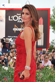 Cindy Crawford accessorized her red Roberto Cavalli gown with an elegant diamond cuff bracelet.