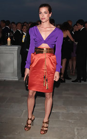 Charlotte donned a vibrant Gucci ensemble with gold gladiator heels for the Art Biennale dinner.