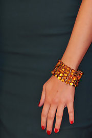 Violante Placido arrived at the premiere of 'Il Vilaggio di Cartone' donning a beautiful amber cuff bracelet.