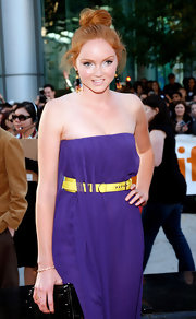 Lily Cole's yellow leather belt provided a nice color contrast to her purple dress at the 'Imaginarium of Doctor Parnassus' screening.