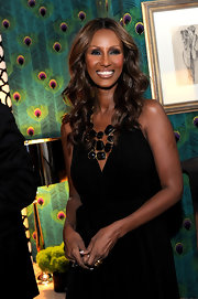 Iman paired her black jumpsuit with an ornate black statement necklace.