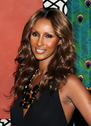 Iman showed off her long curls while hitting the launch of her IMAN Home collection.