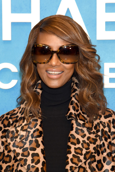 Iman Medium Wavy Cut [michael kors collection spring 2019 runway show,eyewear,hair,sunglasses,face,hairstyle,glasses,blond,hair coloring,vision care,brown hair,iman,front row,new york city,pier 17]