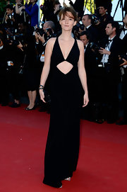 Audrey Marnay chose a black V-neck gown with a bold diamond cutout under the bust for her daring red carpet look at 'The Immigrant' premiere in Cannes.