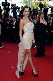 Liliana Matthaeus chose this beaded nude fishtail dress with a mesh halter neck for her flirty red carpet look.