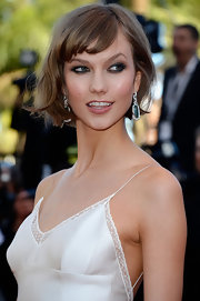 Karlie Kloss kept her bob fun and flirty with a loose wave and bangs!
