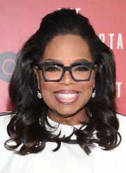 Oprah Winfrey sweetened up her look with this half-up curly hairstyle for the New York premiere of 'The Immortal Life of Henrietta Lacks.'