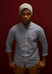 Boyega posed for his Sundance portrait in a grey cap.