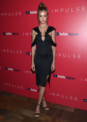 Josephine Skriver looked alluring in a slinky LBD with a plunging neckline and draped sleeves at the premiere of 'Impulse.'