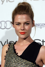 Actress Rachel Taylor showed off one of the hottest hair styles of the season, the top knot. She paired it with bright lipstick for a finishing touch.