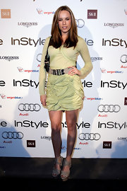 Actress Jessica McNamee showed off her Spring 2010 dress, which she paired with an awesome pair of wedge heels.
