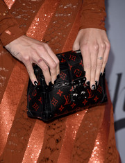 Chiara Ferragni has a cursive tattoo on the side of her hand that says #beautiful.