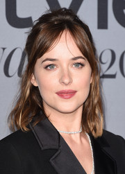 Dakota Johnson worked a messy half-up style at the InStyle Awards.