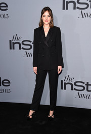 Dakota Johnson went the masculine-chic route in a black Louis Vuitton tuxedo during the InStyle Awards.
