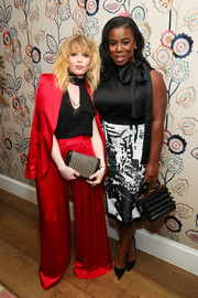 Natasha Lyonne sported an oversized red satin pantsuit at the InStyle Badass Women dinner.