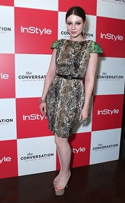 Michelle Trachtenberg got snaky in this iridescent cocktail dress with green cap sleeves.