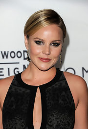 Abbie Cornish wore a metallic silver eyeshadow at the Toronto International Film Festival. Her dramatic look can be recreated by lining the inner rims of eyes with a black eye pencil and then sweeping product like Bobbi Brown Metallic Eye Shadow in Rockstar over lids and along the lower lash line. Several coats of black mascara complete the look.