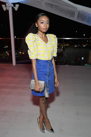 Skai Jackson attended the InStyle and Kate Spade dinner wearing a yellow checkered blouse with puffed sleeves.