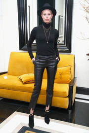 Karolina Kurkova covered up in a plain black turtleneck for the InStyle March issue party.