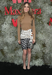 Suki Waterhouse attended the InStyle Max Mara Women in Film celebration wearing a casual tan turtleneck.