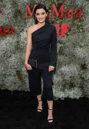 Lucy Hale complemented her jumpsuit with a faceted black clutch.