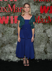 Alice Eve finished off her outfit with black cross-strap sandals.