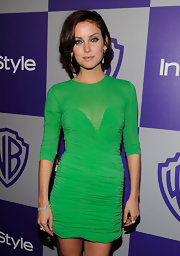 Jessica stole the spotlight in a bold green cocktail dress with a ruched body and a sheer neckline.
