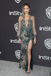 Amber Stevens West went for exotic glamour in a beaded green gown with sheer sleeves and a high slit at the InStyle and Warner Bros. Golden Globes after-party.