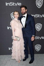 Emily Blunt paired her dress with a silver clutch by Jimmy Choo.