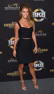 Nina Agdal sheathed her curves in a tight black crop-top for the BKB inaugural event.