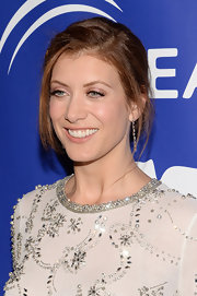 Kate Walsh pinned back her hair into this delicate updo but left some face-framing fly-aways.