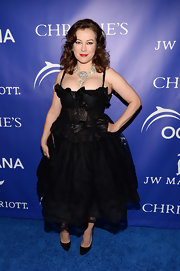 Jennifer Tilly chose a Gothic-inspired black frock with a ruffled lace bodice and a full skirt.