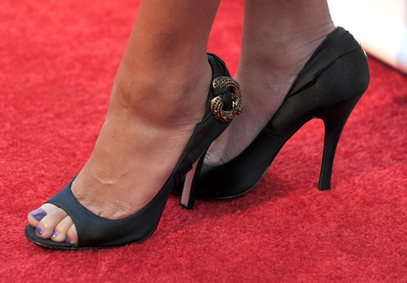 Teen queen Monique Coleman always brings her A-game when on the red carpet and she showed up looking awesome at this event. her satin peep-toe pumps were nicely embellished with golden jewels at the heel.