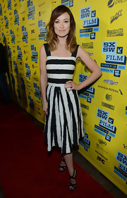 Olivia Wilde kept her red carpet look fun and flirty with this black and white striped cotton A-line.