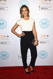 Jessica Alba injected a hint of edge with a studded clutch by Christian Louboutin.