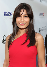 Freida Pinto's crimson lips totally complemented the red hue of her dress.