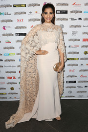 Sonam Kapoor polished off her regal ensemble with a pearlized oval clutch by Thale Blanc.