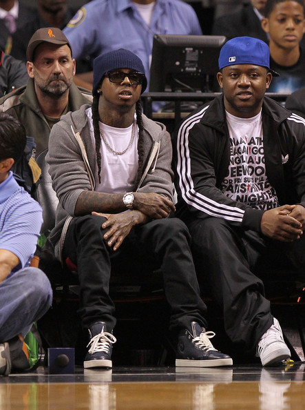 Lil Wayne wore a beanie over his long braids for the Pacers vs Heat basketball game.