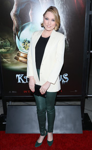 Clare Grant topped off her ensemble with a white boyfriend blazer.