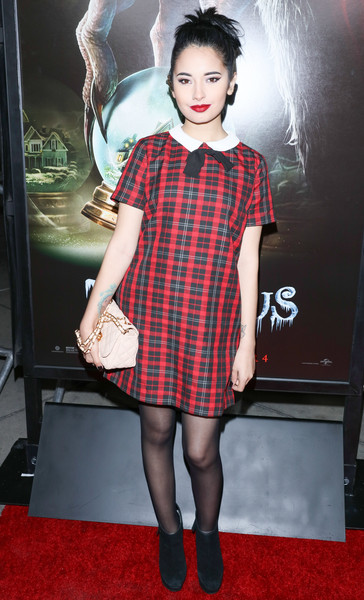 Laura Sanchez looked preppy in a collared plaid mini dress during the screening of 'Krampus.'