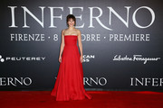 Felicity Jones looked simply divine in a strapless red ball gown by Valentino at the Florence premiere of 'Inferno.'