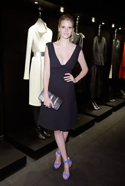 Lara Stone paired her LBD with a bright lilac pair or strappy heels.